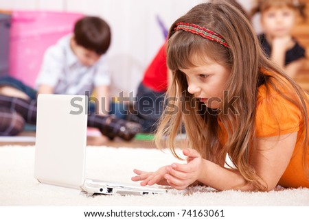 Attractive girl looks attentively at the laptop screen - stock photo