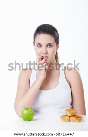Attractive girl makes the choice of isolated - stock photo