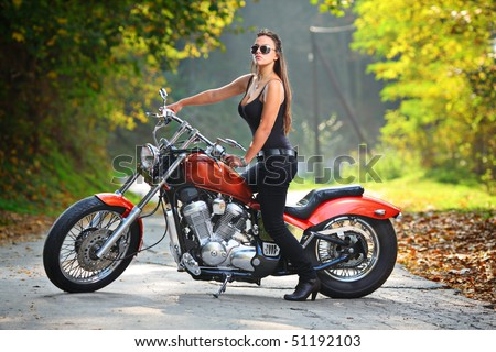 Attractive girl  on a motorbike - stock photo