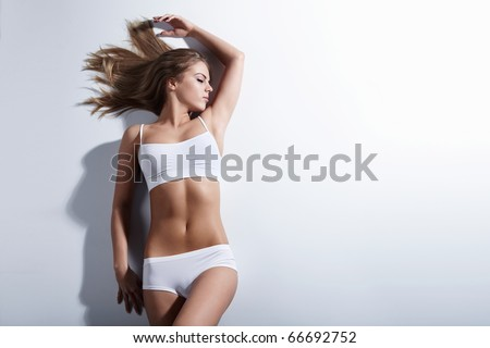 Attractive girl on a white background - stock photo