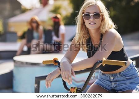 Attractive girl on her bike in the skatepark - stock photo