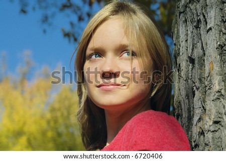 attractive girl on the autumn background