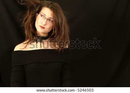 Attractive girl on the black background - stock photo