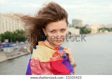 Attractive girl on the bridge over Moscow-river (Russia) - stock photo