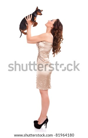 attractive girl plying with  her little dog, isolated on white background - stock photo