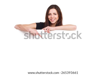 attractive girl pointing to blank ad - stock photo