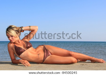 Attractive girl posing on the beach in Greece - stock photo