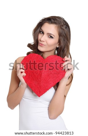 Attractive girl posing with a heart sign - stock photo