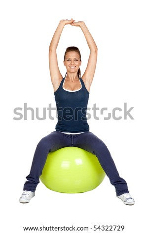 Attractive girl practicing pilates on a big green ball - stock photo