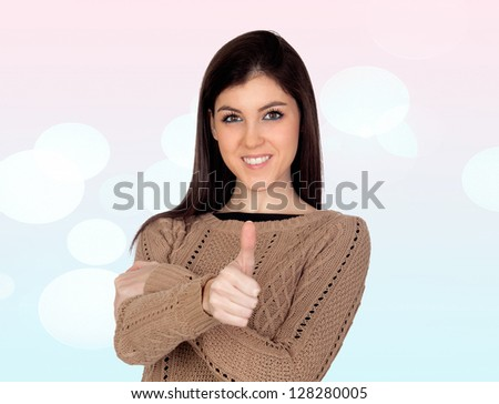 Attractive girl saying OK isolated on a blue and pink background with lights - stock photo
