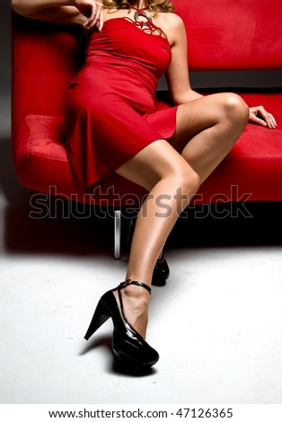 Attractive girl sit on a red couch