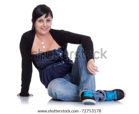 Attractive girl sitting on floor. All on white background. - stock photo