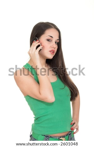 Attractive girl speaking by cellular phone with her boyfriend.