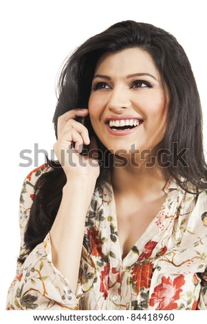 Attractive girl talking on the cell phone with a huge smile - stock photo
