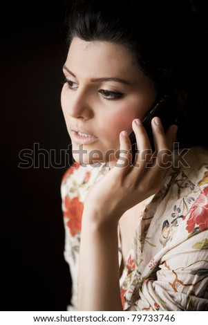 Attractive girl talking over the cell phone. - stock photo