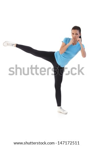 Attractive girl training, kick-boxing. - stock photo