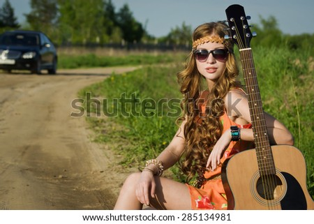 Attractive girl traveling with her car - stock photo