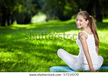 Attractive girl turns and looks into the camera - stock photo