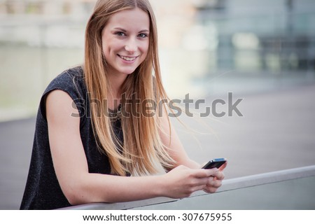 Attractive girl using smart phone