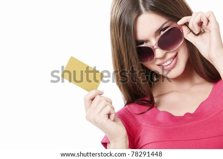 Attractive girl with a credit card on a white background - stock photo