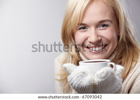 Attractive girl with a cup on a white background