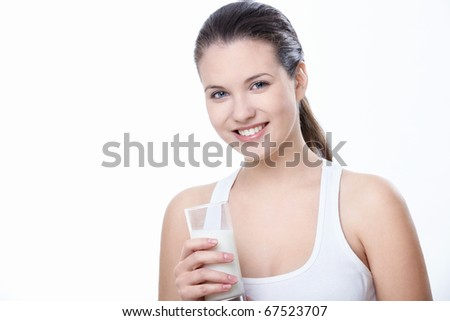 Attractive girl with a glass of milk on a white background - stock photo