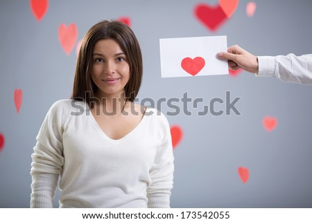 Attractive girl with an envelope - stock photo