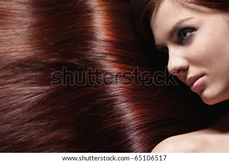 Attractive girl with beautiful healthy hair - stock photo