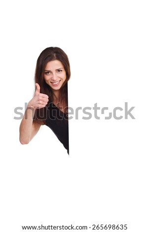 attractive girl with blank ad shows thumb up - stock photo