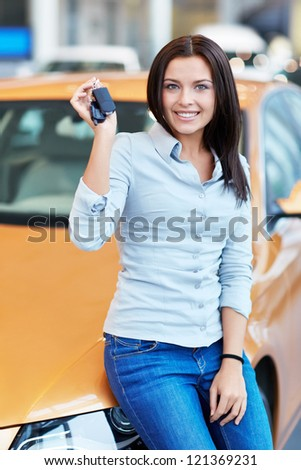Attractive girl with car keys - stock photo