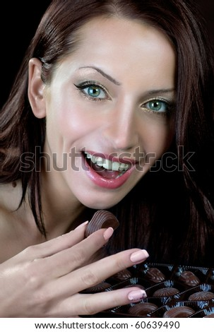 Attractive girl with chocolate candies box
