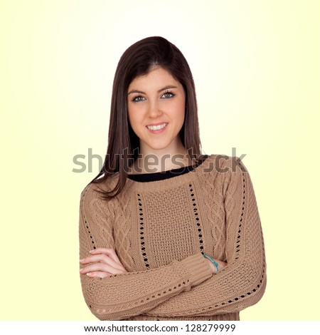 Attractive girl with crossed arms isolated on yellow background - stock photo