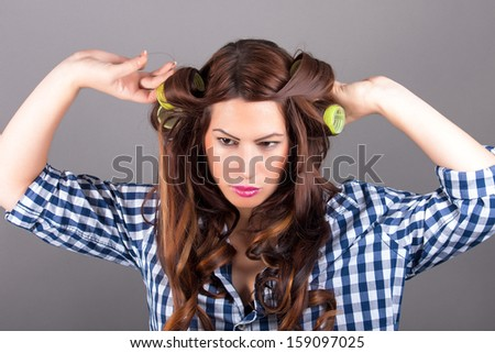 attractive girl with curlers - stock photo