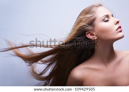 Attractive girl with flying hair - stock photo