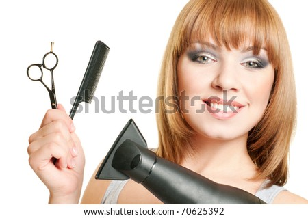 Attractive girl with hairdresser's tools isolated on white background - stock photo