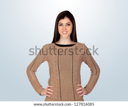 Attractive girl with her hands akimbo isolated on blue background - stock photo