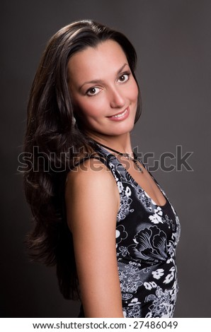 Attractive girl with long black hair - stock photo