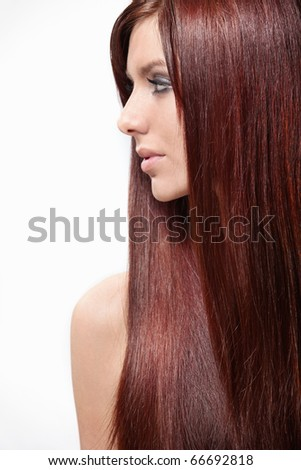 Attractive girl with long hair isolated - stock photo