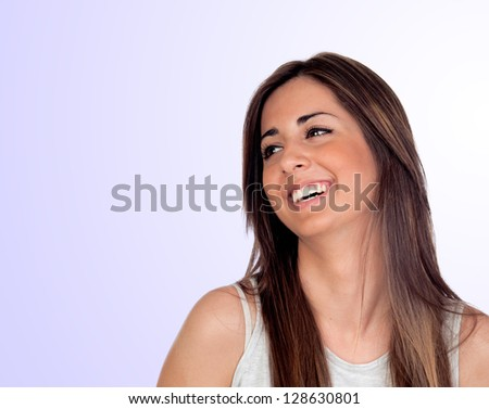 Attractive girl with long hair laughing isolated on blue background