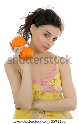 attractive girl with oranges - isolated on white