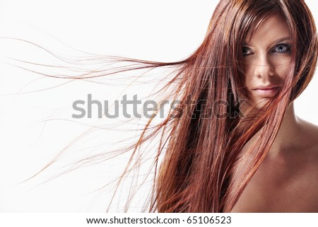 Attractive girl with red hair on a white background - stock photo