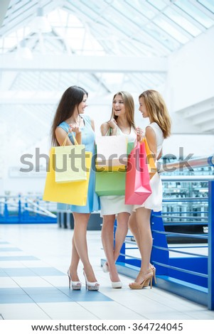 Attractive girl with shopping bag in the store - stock photo