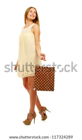 Attractive girl with shopping bag on white background - stock photo