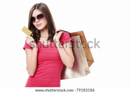 Attractive girl with shopping bags and credit card on a white background - stock photo