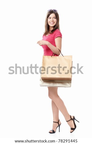 Attractive girl with shopping bags on white background - stock photo