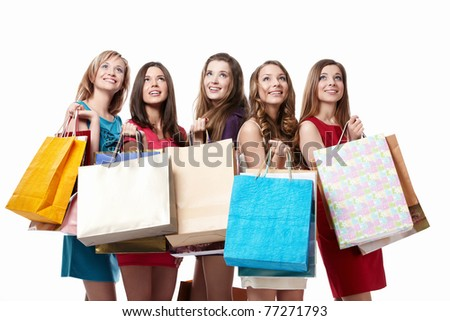 Attractive girl with shopping looking up on white background - stock photo