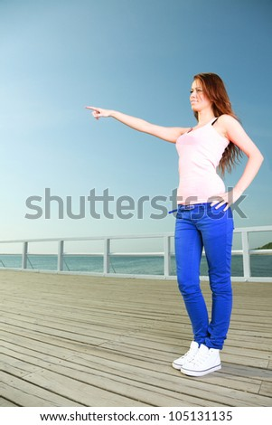 Attractive girl Young woman looking on background of sky