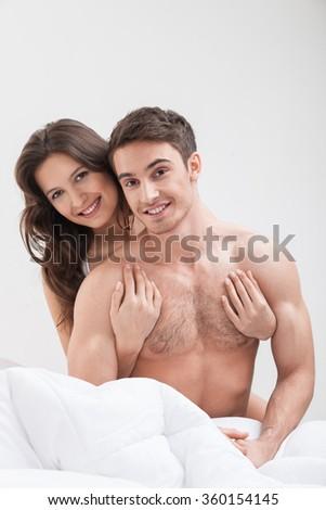 Attractive girlfriend and boyfriend in a bedroom - stock photo