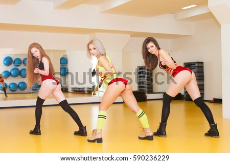 stock-photo-attractive-girls-dancing-twerk-in-the-dance-class-590236229.jpg