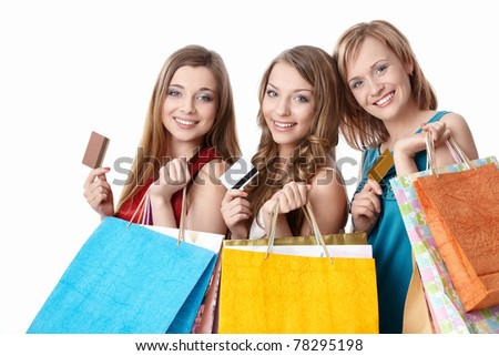 Attractive girls with bags and credit cards on a white background - stock photo